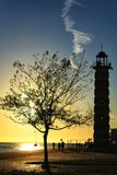 Lighthouse at sunset under blue sky in Lisbon. In winter Royalty Free Stock Image