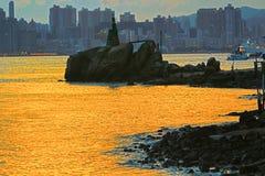 Lighthouse at sunset in Yau Tong Lei Yue Mun. Lighthouse at sunset in  Lei Yue Mun water bay Stock Photos