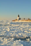 Lighthouse Surrounded by Ice Stock Photo