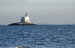 Lighthouse surrounded by ocean Stock Image