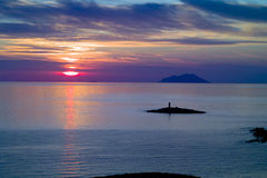 Lighthouse and Svetac Island, Vis at Sunset Stock Photo