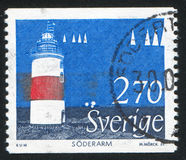 Lighthouse. SWEDEN - CIRCA 1989: stamp printed by Sweden, shows Soderarm, Uppland, Lighthouse, circa 1989 Royalty Free Stock Photo