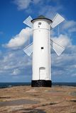 Lighthouse in Swinoujscie. White old lighthouse windmill in Swinoujscie, Baltic Sea, Poland Royalty Free Stock Image