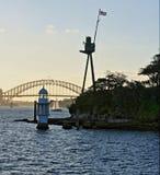Lighthouse in Sydney Harbor near The Coathanger bridge Stock Images
