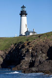 Lighthouse. A lighthouse takes in the morning sunlight along the Oregon coast Royalty Free Stock Photo