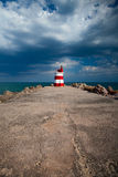 Lighthouse on the Tavira Island before storm Stock Photos