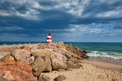 Lighthouse on the Tavira Island before storm Stock Photography