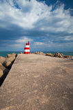 Lighthouse on the Tavira Island before storm, Stock Images