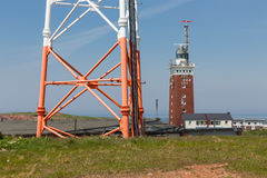 Lighthouse and telecommunication tower at German Helgoland island royalty free stock photo