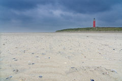 Lighthouse on Texel Island. Landscape photo: View of the lighthouse in the north of Texel Netherlands on a windy autumn day stock photography