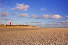 Lighthouse on Texel in The Netherlands in morning light Stock Images