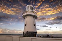 Lighthouse in Thailand. Close up lighthouse in Thailand . Tsunami siren warning loudspeakers are installed on the  shores in Thailand Royalty Free Stock Photography