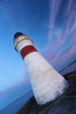 Lighthouse in tilted position with colorful sky. Lighthouse in tilted position with blue colorful sky Royalty Free Stock Photos