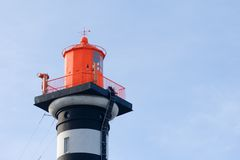 Lighthouse top. Top of the lighthouse under blue sky Stock Photo