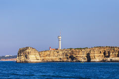 Lighthouse on top of cliff at Cabo Sao Vicente, Algarve region, Stock Photos