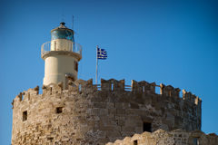 Lighthouse on a top of tower. Coast in Rhodes, Greece stock photos
