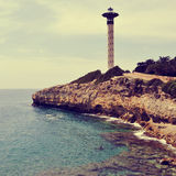 Lighthouse in Torredembarra, Spain, with a retro effect Royalty Free Stock Images