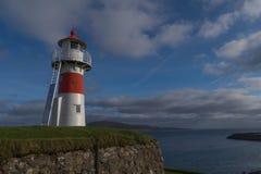 Lighthouse, Torshavn, Faroe Islands, Denmark. Colourful and bright lighthouse in Torshavn on Streymoy island, Faroe Islands, Denmark. In the background Nolsoy Stock Photography
