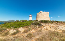 Lighthouse and tower. Lighthouse and Aragonese tower in Porto Conte, Sardinia Royalty Free Stock Image