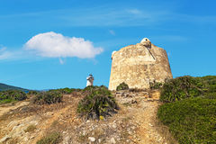 Lighthouse and tower. Lighthouse and Aragonese tower in Porto Conte, Sardinia Royalty Free Stock Photo