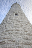 Lighthouse tower perspective. From the base of a tall white light house, extreme perspective looking up to the top royalty free stock images