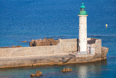 Lighthouse tower, Propriano, Corsica, France. White lighthouse tower with green top. Entrance to Propriano port, Corsica, France Royalty Free Stock Photography