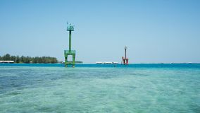 A lighthouse traditional steel tower with blue sea in karimun jawa port stock images