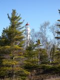 Lighthouse in the trees. Lighthouse on Lake Michigan Stock Photography
