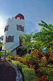 Lighthouse in tropical garden on Grenada Island. Saint Vincent and the Grenadines Royalty Free Stock Photo