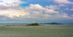 Lighthouse on tropical island Royalty Free Stock Image