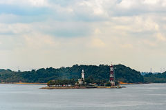 Lighthouse on tropical island Stock Image