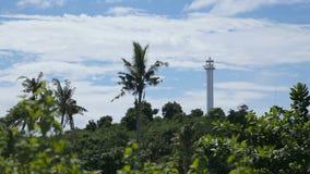 Lighthouse and tropical palms.Malapascua Island stock footage