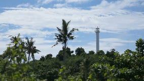 Lighthouse and tropical palms.Malapascua Island stock video