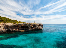 Lighthouse on turquoise sea royalty free stock images