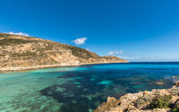 Lighthouse and turquoise sea at Revellata in Corsica Stock Images