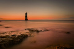 Lighthouse at Twilight. Penmon Lighthouse in North Wales at twilight Royalty Free Stock Photography