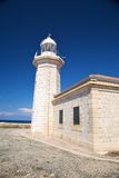 Lighthouse and two windows Royalty Free Stock Photos
