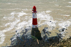 Lighthouse UK. A lovely coastal scene at Beachy Head which is near Eastbourne UK showing a lighthouse royalty free stock photo