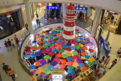 Lighthouse and Umbrella Decoration in Terminal 21 Shopping Mall. Red and White Striped Lighthouse and Colorful Umbrella Decoration in Terminal 21 Shopping Mall Royalty Free Stock Photos
