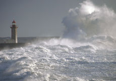 Lighthouse under big waves Royalty Free Stock Photography