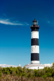 Lighthouse under blue sky Stock Image