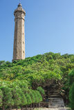 Lighthouse under blue sky and cloud. Flying Stock Photos
