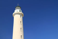 Lighthouse under bright blue sky Royalty Free Stock Photography
