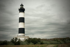 Lighthouse under cloudy sky Royalty Free Stock Image