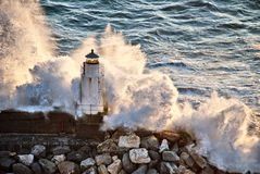 Lighthouse under the power of the waves royalty free stock photography
