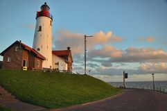 The Lighthouse in Urk. September 2012, Urk, Netherlands. Side view of the lighthouse on the sea coast in sunset Stock Image