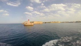 Lighthouse in Valletta. View on Lighthouse in Valletta from sea stock video