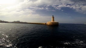 Lighthouse in Valletta. View on Lighthouse in Valletta from sea stock video footage