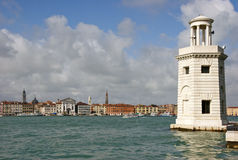 Lighthouse and Venice waterfront Royalty Free Stock Image