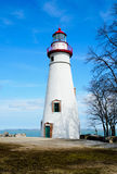 Coastal Lighthouse, Blue Sky. Exterior of white and red lighthouse,with blue sky background U.S.A Royalty Free Stock Image